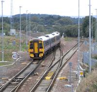 The daily Edinburgh - Alloa direct service leaves the EGML at Polmont Junction on 2 September. Note the floodlights that have recently been installed here, as at other EGML junctions.<br><br>[David Panton&nbsp;02/09/2009]
