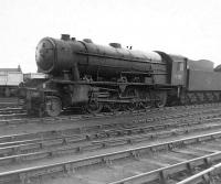 Ex-WD 2-10-0 no 90756 stands in sidings alongside 66B Motherwell Shed on 14 April 1963, almost 4 months after official withdrawal by BR. The locomotive was finally cut up in Darlington Works scrapyard in November of that year.  <br><br>[David Pesterfield&nbsp;14/04/1963]