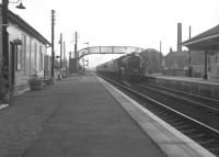 View south at Glengarnock in June 1963 as a Jubilee 4-6-0 approaches with an Ayr-Glasgow train. [See image 29987]<br><br>[Colin Miller&nbsp;/06/1963]