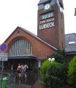 The approach to Travemunde Strand station in July 2009. The station clock shows a few minutes after 5pm, with the panel below displaying the time of the next train departure, the 17.31 service to Lubeck.<br> <br><br>[John Steven&nbsp;/07/2009]