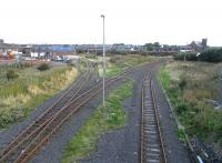 View north east from Ayr Harbour Junction on 2 September 2009. The line on the left runs to Falkland Junction, to the right is the line for Newton Junction with Newton-on-Ayr station located behind the EWS waggons in the background.<br><br>[David Panton&nbsp;02/09/2009]