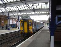 On 2 September 156 494 pulls into Ayr with a service to Kilmarnock over the <I>Burns Line</I>. Loadings are generally light, at least between Ayr and Kimarnock: I caught this train and had the carriage to myself all the way.�Ayr and Kilmarnock stations have the same platform arrangement and, as at Kilmarnock, most through trains in both directions use Platform 3.�The ticket barrier on Platform 4 (left) is needed to prevent free access to the other platforms (there is a ticket machine on that side of the station). <br> <br><br>[David Panton&nbsp;02/09/2009]