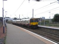 View south at Newton-on-Ayr on 2 September as 318 255 arrives with an Ayr - Glasgow Central service.<br><br>[David Panton&nbsp;02/09/2009]