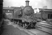 One of the push-pull fitted Reid ex-NB C15s no 67460 at Eastfield in July 1959. The locomotive was used on the Craigendoran - Arrochar service for many years along with classmate 67474 [see image 24286]. Built by the Yorkshire Engine Co in 1912, withdrawal of both (the last surviving examples) took place in April 1960, at which point a diesel railbus took over the service. Both C15s were cut up at Cowlairs works the following month.<br> <br><br>[Robin Barbour Collection (Courtesy Bruce McCartney)&nbsp;29/07/1959]
