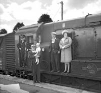 Members of the crew of the last freight pose with a small group of family and friends at Earlston station on 16 July 1965. The lady and gentleman on the right are Jock and Nessie Craw who lived in the 'Crossing House' at the East End of the village. Jock was a linesman and his wife operated the crossing gates.   The gentleman holding the child is Stationmaster Norman Jaffray. The child is Colin Craw, son of Jock and Jessie. [With thanks to Sheila McKay, Auld Earlston]   <br><br>[Bruce McCartney&nbsp;16/07/1965]