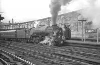 Peppercorn A1 Pacific no 60157 <I>Great Eastern</I> darkens the sky over Carlisle station in the summer of 1964 as it prepares to take forward the 1.40pm Stranraer Harbour - Newcastle Central.<br><br>[K A Gray&nbsp;25/07/1964]
