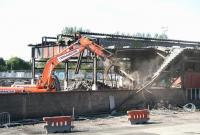 Bathgate no more.... the demolition squad in the process of tearing down the former 64F shed on 11 September 2009. [See image 22760]<br> <br><br>[John Furnevel&nbsp;11/09/2009]
