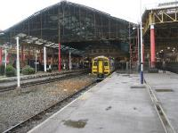 At the east end of Manchester Victoria there are still some  platforms in use. On the right are the bay platforms on the national rail network while on the left is the through island platform used by the Metrolink trams. Beyond the station the Metrolink goes onto street running through the city centre. Out of shot on the far right are the through platforms on the national network above which is the Manchester Evening News Arena. The photograph makes an interesting comparison with that taken by Ian Dinmore [see image 12938]<br><br>[John McIntyre&nbsp;30/09/2008]