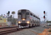 Pictured leading the northbound <I>Pacific Surfliner</I> train #579 into Oceanside Transit Center is AMTRAK cab car unit #6907.� The train left San Diego at 13:25 and was scheduled to arrive in Los Angeles at 16:05.�The day when the sun DIDN'T shine in Southern California is Friday, 21 August, 2009.<br> <br><br>[Andy Carr&nbsp;21/08/2009]