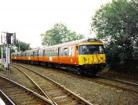 A Class 303 emu on a service from Newton to Glasgow Central via Maxwell Park in September 1997 is photographed skirting Cathcart station.<br><br>[David Panton /09/1997]