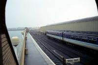 It is early morning and very wet in this view south from the top of the steps on the covered footbridge looking along the external platform at Stranraer Harbour on 28 April 1990. <br><br>[John McIntyre&nbsp;28/04/1990]