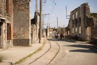 The historic village of Oradour, France, showing the old village tram line and overhead wires. Oradour was destroyed by the Waffen SS on 10 June 1944 in reprisal for Resistance attacks. The village has been left as a memorial to that day.<br> <br><br>[Peter Todd&nbsp;12/09/2009]