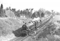 Jubilee 4-6-0 no 45588 <I>Kashmir</I> westbound on the former Dumfries, Lochmaben and Lockerbie Junction route on 15 April 1963 with the 4-day SLS/BLS Easter Special Rail Tour <I>'Scottish Rambler no 2'</I>. The special is seen here approaching Dumfries. <br> <br><br>[K A Gray&nbsp;15/04/1963]