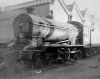 J39 0-6-0 no 64747 in a siding alongside Woodford Halse shed in October 1963. A village in rural Northants with a population of around 1,500, Woodford Halse was transformed with the arrival of the GCR London extension. This resulted in construction of a large locomotive shed and goods yard, with housing and other facilities for railway workers.  How times change. The station, shed and yards were closed in the mid 1960s and the village has now returned to its former quiet rural state with little sign that the railway was ever there. <br> <br><br>[David Pesterfield&nbsp;20/10/1963]
