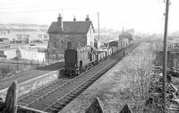 The returning branch pick-up goods rumbles through Earlston at Easter 1965 on its way back from Greenlaw to St Boswells.<br><br>[Bruce McCartney&nbsp;//1965]