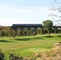A DMU crosses the viaduct over Greenburn golf course shortly after leaving Fauldhouse station on 15 September with a Glasgow Central - Edinburgh Waverley service.<br><br>[John Furnevel&nbsp;15/09/2009]