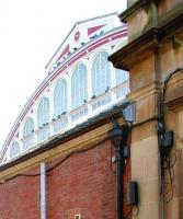 Part of the west end of Helensburgh Central station, with its striking fanlight, being enjoyed by the usual gathering of pigeons. Photograph taken in April 2005 through the (locked) metal gates at the entrance to the alley from Princes Street. [See image 3728]  <br><br>[John Furnevel&nbsp;23/04/2005]