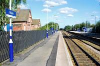 Looking west at Irlam, Greater Manchester, on 10 September 2009. The strange set back position of the old station building in relation to the platforms gives away the fact that the line was re-aligned in 1893 when the Manchester Ship Canal opened.<br><br>[Ewan Crawford&nbsp;10/09/2009]