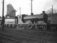 Reid ex-NBR D30 <I>Scott</I> class no 62427 <i>Dumbiedykes</i> stands in front of the ash disposal plant at Dunfermline shed (62C) on a February evening in 1959. The locomotive was withdrawn from here 2 months later and subsequently cut up at Inverurie Works.<br><br>[Robin Barbour Collection (Courtesy Bruce McCartney)&nbsp;11/02/1959]