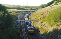 A soundbound freight has just crossed over Shap Summit. This is the view from the very high footbridge just to the south.<br><br>[Ewan Crawford&nbsp;10/09/2009]