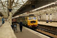 Class 47 no D1916 on the Compass railtour in Platform 6 at Aberdeen on 25 September 2009. <br><br>[John McIntyre&nbsp;25/09/2009]