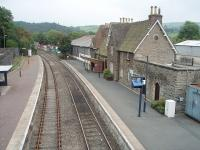 At the time of this photo Knighton's passing loop was out of action  and a sign proclaimed that all trains (4 each way a day) departed from Platform 1. New electrically operated points were later installed and the loop is now fully operational again with both platforms in use. View towards Craven Arms from the station footbridge.<br><br>[Mark Bartlett&nbsp;19/09/2009]