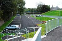 Dalreoch's new extension to the station carpark is open. The line is to the left. This carpark features a very pleasant area complete with picnic benches down by the River Leven.<br><br>[Ewan Crawford&nbsp;26/09/2009]