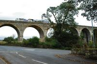 Tamper paused on the viaduct south of Stewarton. The view looks east.<br><br>[Ewan Crawford&nbsp;26/09/2009]