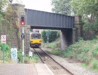 143614 uses the new (1984) link from the Coryton branch to join the Rhymney line at the relocated Heath Junction. Prior to that date trains from Coryton turned right under the bridge, where the extra <I>SPAD</I> signal is, and ran alongside the Rhymney line for over 400 yards to the junction signal box. That land was sold for housing when the new link and junction were made. The Arriva Class 143 is on one of the half hourly Coryton Cardiff Radyr services.<br><br>[Mark Bartlett&nbsp;18/09/2009]
