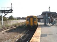 The once extensive through station at Barry Island  is now a single track terminus but still enjoys a half hourly service to Cardiff.  150285 is ready to leave for Aberdare and some of the old station features can be seen as well as the modern shelter.<br><br>[Mark Bartlett&nbsp;18/09/2009]