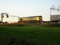Freightliner 66570 held at signals south of Winsford Station on Intermodal working <br><br>[David Pesterfield&nbsp;09/09/2009]
