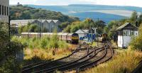 The Royal Scotsman lies over in the Keith and Dufftown Railway's platform at Keith. Meanwhile an Aberdeen service waits for passengers at the mainline platform. The building on the left was formerly the locomotive shed, now part of the Chivas site.<br><br>[Ewan Crawford&nbsp;30/09/2009]