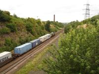 66537 heads east towards Normanton, & Leeds Freightliner Terminal, passing the former Goose Hill Junction. The old Midland main line trackbed runs to the right of the existing line. <br><br>[David Pesterfield&nbsp;04/09/2009]