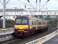 Arriving at platform 2 of Helensburgh Central on 21 September 2009 is 320 305 with a service from the far east (Drumgelloch).<br><br>[David Panton&nbsp;21/09/2009]