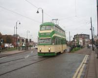 Blackpool <I>Balloon Car</I> No. 717 has been restored to original condition (apart from the pantograph replacing the trolley pole) and makes a fine sight entering the street running section in Fleetwood. Most of the remaining 1930s double deck tram cars have been either completely rebuilt or at least heavily modified [see image 23650]. <br><br>[Mark Bartlett&nbsp;06/10/2009]