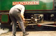 Ffestiniog Railway 2-6-2T <I>Mountaineer</I> receives attention at Tan-Y-Bwlch on 25 July 1992.<br><br>[Ken Browne&nbsp;25/07/1992]
