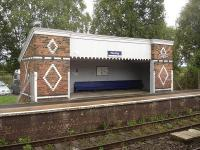 Decorative east-bound waiting shelter at Plumley Station on Stockport to Chester line, with long bench seat along most of back wall. <br><br>[David Pesterfield&nbsp;01/09/2009]