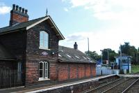 Mobberley looking at the Chester bound platform, level crossing and signalbox.<br><br>[Ewan Crawford&nbsp;10/09/2009]