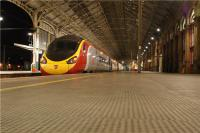 A northbound Pendolino pauses on a deserted Platform 3 at Preston on the evening of 10 October 2009. All the activity was over on Platform 6 (to the right) where A1 Pacific 'Tornado' had arrived with a railtour from Carlisle.<br><br>[John McIntyre&nbsp;10/10/2009]