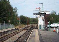 The start of the single line section to Rhymney is controlled by semaphore lower quadrant signals from Bargoed's plain looking Signal Box. Some services from Cardiff terminate here and then return down the Rhymney Valley.<br><br>[Mark Bartlett&nbsp;19/09/2009]