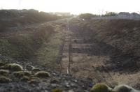 A view with all the existing lines visible. The two remaining sidings in the Long Lyes are visible, as vegetation clearance extended right along to the connection with the Troon line, which can just about be seen glinting in the distance.<br><br>[Robert Blane&nbsp;06/03/2009]