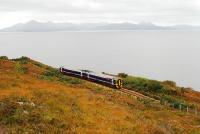 A Sprinter heading to Inverness runs by the coast between Portnacroish and Duirinish. On the horizon is the Cuillin range on Skye.<br><br>[Ewan Crawford&nbsp;01/10/2009]