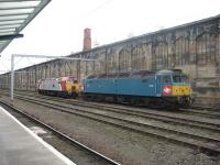 Brush Type 4 D1733 / 47853 rests in the sidings by Carlisle station. The locomotive is painted in the old XP64 Inter City prototype livery from the late 60s.<br><br>[Bruce McCartney&nbsp;12/10/2009]