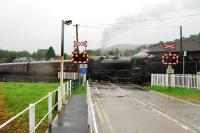 The <i>Jacobite</i> crosses the level crossing by Corpach station on its return to Fort William.<br><br>[Ewan Crawford&nbsp;28/09/2009]