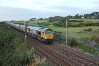 66714 (GB) 'Cromer Lifeboat' at Lochgreen south of Troon heading 4N50 1150 Lynemouth-New Cumnock empty MGR. GBRF have recently won contract for this flow. Trains started on 11th August and the contract is expected to run for eight weeks. Portland Golf course to the right of train, Royal Troon behind camera position.<br><br>[Colin Howat&nbsp;25/09/2009]