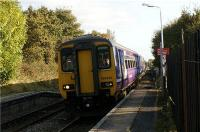 A Northern Rail Hazel Grove to Preston service passes Adlington station at speed on the afternoon of 16 October 2009. Standing behind the yellow line is not so easy at this station due to the narrowness of the platforms.<br><br>[John McIntyre&nbsp;16/10/2009]