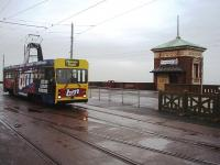OMO (One man operated) <I>Centenary</I> tram 647 is about to use the crossover in the foreground to reverse at the Cabin and go back to the Pleasure Beach on a very overcast day. The Cabin Lift in the background takes pedestrians down over forty feet to the lower promenade. 647 worked until the very last day of traditional trams in service, in November 2011.<br><br>[Mark Bartlett&nbsp;06/10/2009]