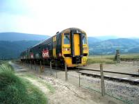 An Arriva Trains Wales 158 service in <I>Ginsters</I> advertising livery photographed on the Cambrian Coast line near Barmouth Viaduct on 3 July 2006.<br><br>[Bruce McCartney&nbsp;03/07/2006]