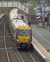 334040 at the head of a service to Glasgow Central drawing away from Johnstone on 7th October 2009<br><br>[Graham Morgan&nbsp;07/10/2009]