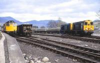 PW trains at Blair Atholl on 23 April 1982. Locomotives are 27205, 20067 & 20040.<br> <br><br>[Peter Todd&nbsp;23/04/1982]